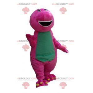 Baculatý a zábavný obří růžový a zelený dinosaur maskot -