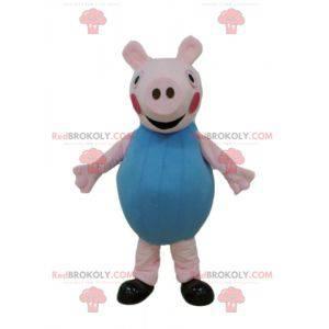 Różowa maskotka świnia ubrana na niebiesko - Redbrokoly.com