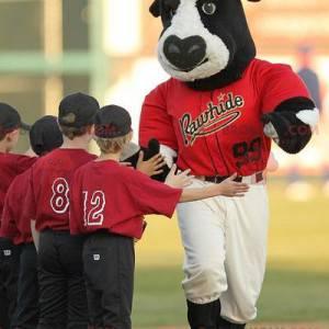 Black and white bull buffalo mascot in baseball outfit -