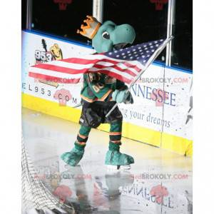 Maskot zelené želvy s korunou a hokejovým oblečením -