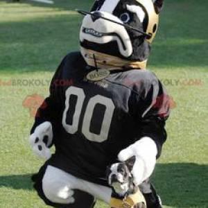 Schwarzweiss-Hundemaskottchen mit einem Helm und einem