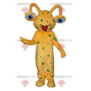 Yellow alien mascot with green peas - Redbrokoly.com