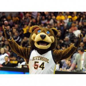Medvěd hnědý maskot s modrýma očima v sportovní oblečení -