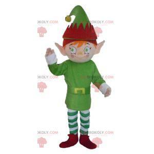 Elf elf maskotka ubrany w zielony, biały i czerwony -