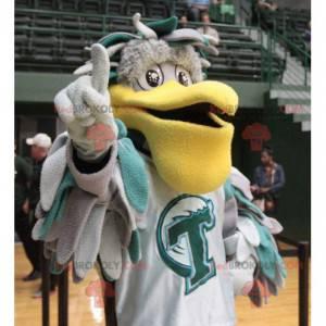 Šedý a zelený maskot pelikán s velkým žlutým zobákem -