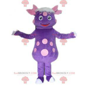 Dinosaur mascot with polka dots. Purple creature mascot -