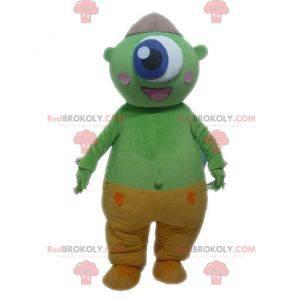 Grünes außerirdisches Maskottchen. Grünes Zyklopenmaskottchen -