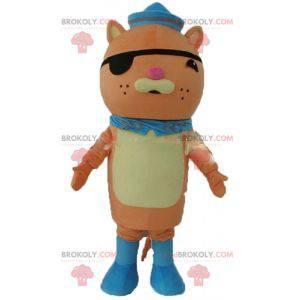 Maskot oranžové kočky s páskem přes oko a námořnickou čepicí -