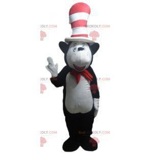 Maskot černé a bílé medvědice s velkým kloboukem -