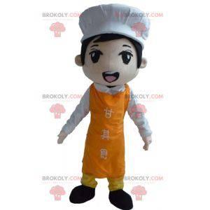 Asiatisches Kochmaskottchen mit einer Schürze und einer