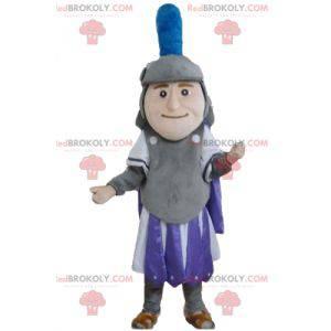 Mascote do cavaleiro em traje roxo e cinza branco -