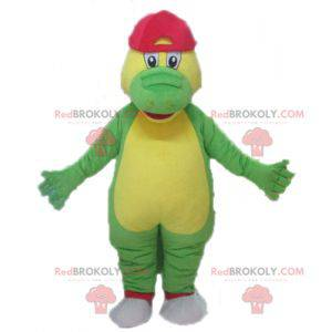 Green and yellow crocodile mascot with a red cap -