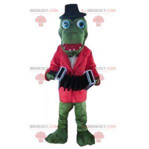 Zelený krokodýlí maskot s červenou bundou a akordeonem -