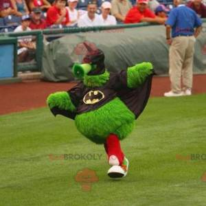 All hairy green monster mascot dressed as Batman -