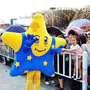 Giant yellow star mascot with a blue outfit - Redbrokoly.com