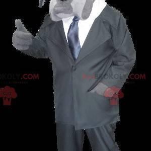 Gray dog mascot dressed as a private investigator -