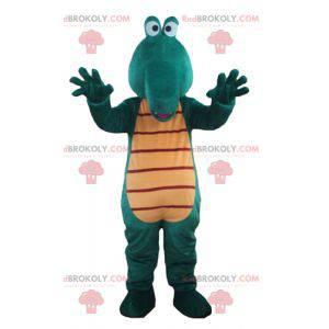 Gigantisk og morsom grønn og gul krokodille maskot -