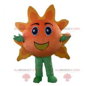 Riesiges orange und gelbes Sonnenmaskottchen sehr lächelnd -