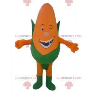Obří oranžový a zelený maskot kukuřičného klasu s úsměvem -