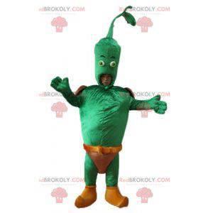 Riesiges grünes Gemüsemaskottchen mit einem braunen Slip -
