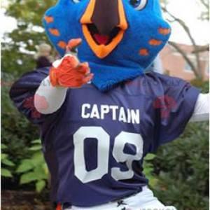Blue and orange bird mascot in sportswear - Redbrokoly.com