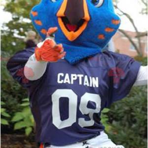 Modré a oranžové ptačí maskot ve sportovním oblečení -