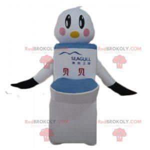 Weißer und schwarzer Maskottchenvogel mit riesigen Toiletten -