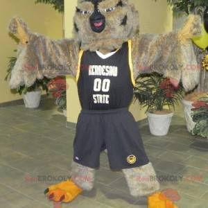 Hnědá a černá sova maskot ve sportovním oblečení -
