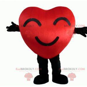 Gigantyczna czerwona i czarna maskotka serca i uśmiechnięty -