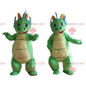 2 niedliche und bunte grüne und blaue Dinosauriermaskottchen -