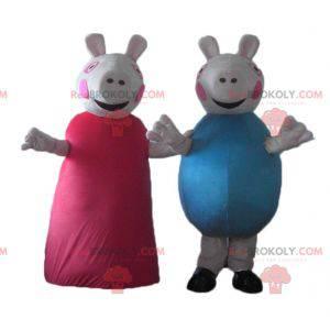 2 Schweinemaskottchen, eines in Rot, das andere in Blau -