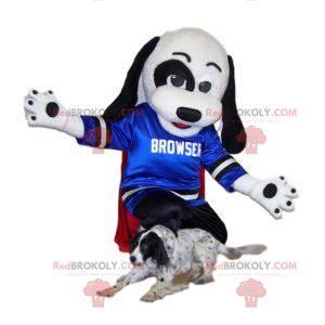 Schwarz-Weiß-Hundemaskottchen mit seinem blauen Trikot zur
