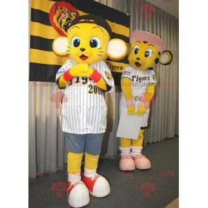 2 maskoti malých žlutých tygrů ve sportovním oblečení -