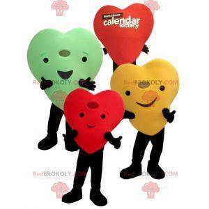 3 mascotas de corazones de colores gigantes y sonrientes -