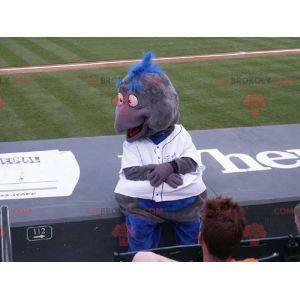 Graues und blaues Vogelmaskottchen in Sportbekleidung -