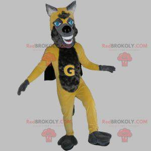 Gelbes und graues Wolfsmaskottchen mit einem Umhang -