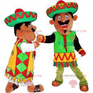 2 Mexican mascots dressed in traditional outfits -