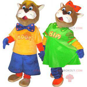 2 mascots of brown and white cats in colorful outfits -