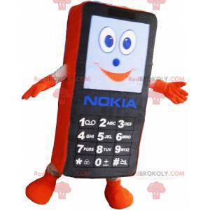 Maskot černé a oranžové mobilní telefon. Maskot GSM -