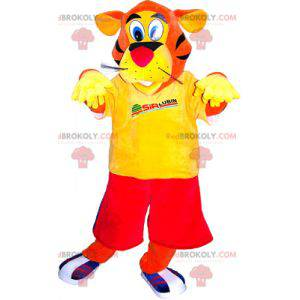 Orange tiger mascot dressed in red and yellow - Redbrokoly.com