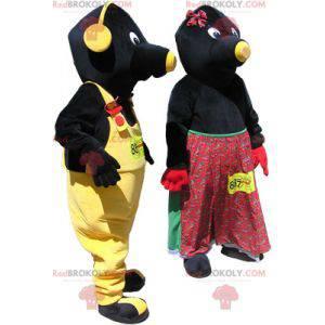 2 Maskottchen: ein paar schwarze und gelbe Maulwürfe -