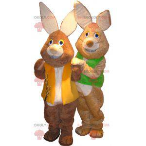 2 mascots of brown and white rabbits with colored vests -