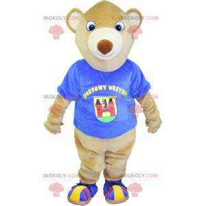 Béžový maskot medvídka s modrým tričkem - Redbrokoly.com