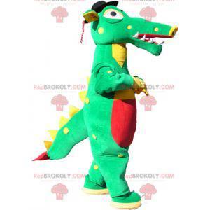 Grønn, gul og rød krokodillemaskot med svart hatt -