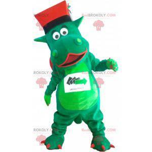 Grünes riesiges Dinosauriermaskottchen mit einem Hut -