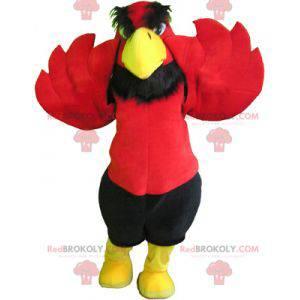 Červený a žlutý orel maskot s černými kraťasy - Redbrokoly.com