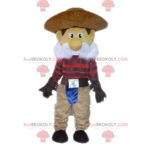 Cowboy-Maskottchen mit Schnurrbart im traditionellen Outfit -