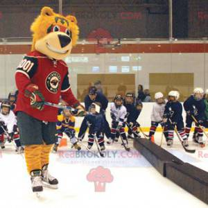 Orangenbärenmaskottchen in Hockeyausrüstung - Redbrokoly.com