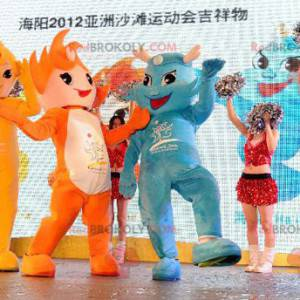 3 mascots of very colorful orange, yellow and blue snowmen -
