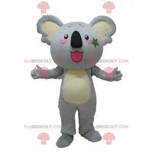 Reusachtige en schattige grijze en gele koala-mascotte -